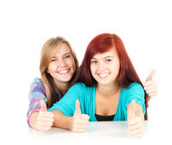 Young female friends with thumbs up Royalty Free Stock Photography
