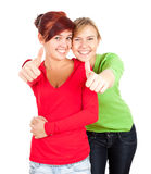 Young female friends with thumbs up Stock Image