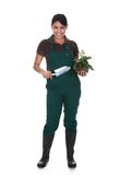 Young female gardner with gardening tools Stock Images