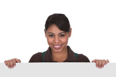Young Female Gardner Holding Placard Stock Photography