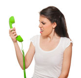 Young female getting angry on the phone. Stock Photo
