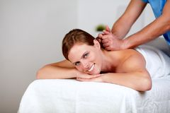Young female getting a back massage by a masseuse Stock Photos