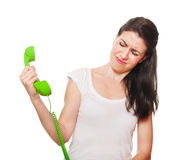 Young female getting stressed on the phone. Royalty Free Stock Image