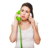 Young female getting stressed on the phone. Stock Image