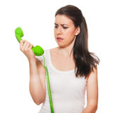 Young female getting stressed on the phone Royalty Free Stock Photo