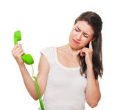 Young female getting stressed on the phone. Royalty Free Stock Images