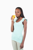 Young female with glass of orange Royalty Free Stock Photography