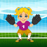 Young female goalkeeper in a ready position Stock Image