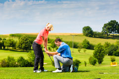 Young female golf player on course stock photography