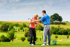 Young female golf player on course Royalty Free Stock Image