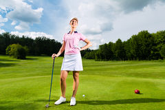 Young female golf player on course Royalty Free Stock Photos