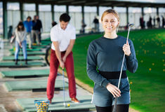 Young female golfer is ready for play Stock Photo