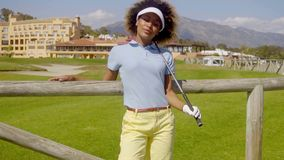 Young female golfer relaxing on the course stock video footage