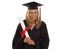 Young female graduate. Young woman with graduation gown and diploma Stock Images