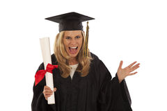 Young female graduate. Young woman with graduation gown and diploma Stock Photography