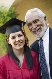 Young Female Graduate With Grandfather Stock Photography