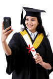 Young female graduated student taking selfie Stock Photography