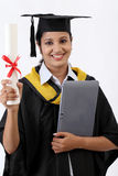 Young female graduated student using a tablet computer Royalty Free Stock Photos