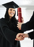 Young female graduating Royalty Free Stock Image