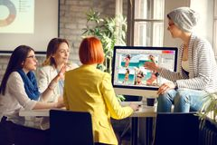 Graphics designers team agreeing about design of front page royalty free stock images