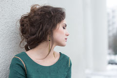 Romantic Caucasian Woman in Green Dress over White Wall outside. Solitude Stock Photography