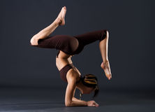 Young female gymnast. Is stretching her body in a studio stock photos