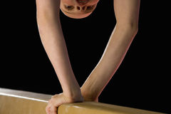 Young female gymnast performing on balance beam, low section Stock Images