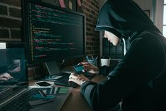 Young female hacker stolen credit card information. Pretty young female hacker stolen credit card information and using personal account making trading through royalty free stock photo