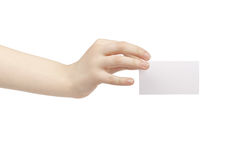 Young female hand hold blank white paper card. Isolated on white Stock Photography