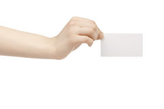 Young female hand hold blank white paper card. Isolated on white Royalty Free Stock Photo