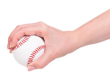 Young female hand. Holding baseball ball isolated over white background Stock Images