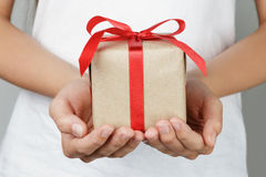 Young female hands holding gift Royalty Free Stock Image