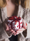 Young female hands holding single gift box Royalty Free Stock Image