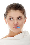 Young female having fever. Feeling bad, checking her temperature Royalty Free Stock Images