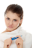 Young female having fever. Feeling bad, checking her temperature Stock Photo