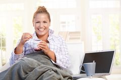 Young female having low fat breakfast in bed Stock Photos