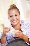 Young female having low fat breakfast in bed Royalty Free Stock Photography