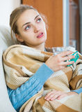 Young female having quinsy and fever and staying in couch Royalty Free Stock Photo