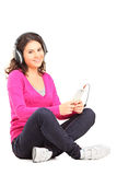 Young female with headphones listening to music Royalty Free Stock Photography