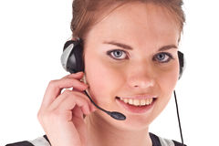 The young female with headset and smile. Isolated on white Royalty Free Stock Photos