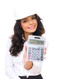 Young Female in Helmet Showing Calculator Device Royalty Free Stock Images