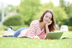 Young female with her laptop Royalty Free Stock Photos