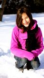 Young female hiker. A young female hiker walking through a winter forest Stock Images