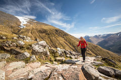 Young female hiker going uphill Royalty Free Stock Image