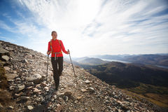 Young female hiker going uphill Royalty Free Stock Photos