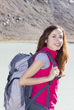 Young female hiker outdoors with her backpack. Woman trekking in nature in autumn on Swiss alps Royalty Free Stock Photography