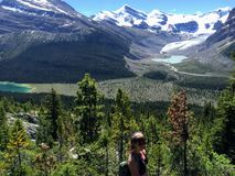 A young female hiker hiking along the Berg Lake Trail, in Mount Robson Provincial Park stock photo