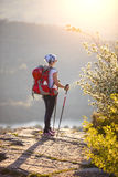 Young female hiker standing on cliff Royalty Free Stock Images