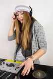 Young female hip-hop dj playing Stock Photography