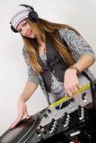 Young female hip-hop dj playing Royalty Free Stock Images